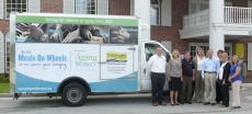 Community Credit Union Executives Preview New Meals on Wheels Truck